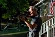 Clint Eastwood firing a gun in 'Gran Torino'